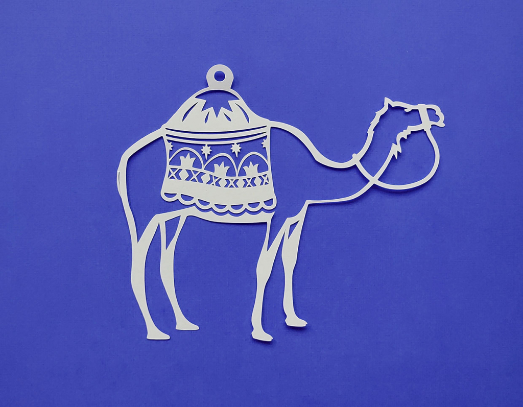 Detailed paper cut camel and saddle