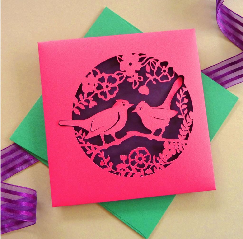 pink paper cut envelope of 2 love birds part of wedding stationery set